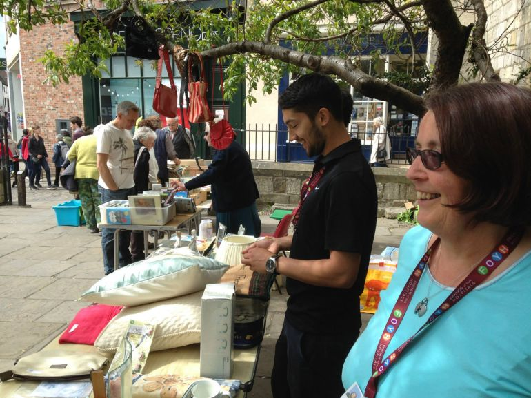 Volunteers at a fundraising stall