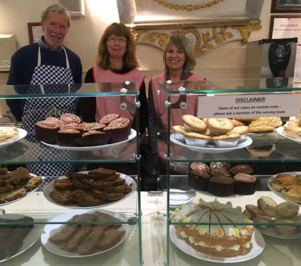 Volunteers with a display of cakes for sale