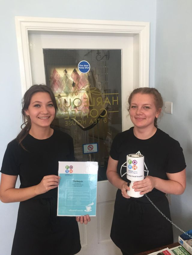 Staff from Harlequin coffee with a FOYH donation box
