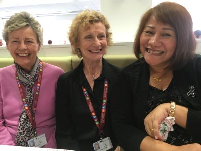 Three members at a coffee morning